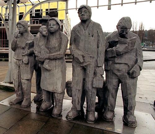 "Richard Beyer carved a lot of stone, but he is better known for his cast metal work. This one, ""Waiting for the Interurban"", is his 1978 cast aluminum installation in the Fremont neighborhood of Seattle."