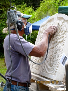 Mark Andrews working on a Limestone Relief