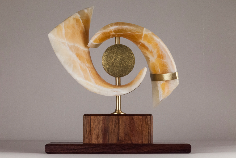 "CAT'S EYE NEBULA, 22"" X 21"" X 8"", Utah honeycomb calcite with walnut & brass base"
