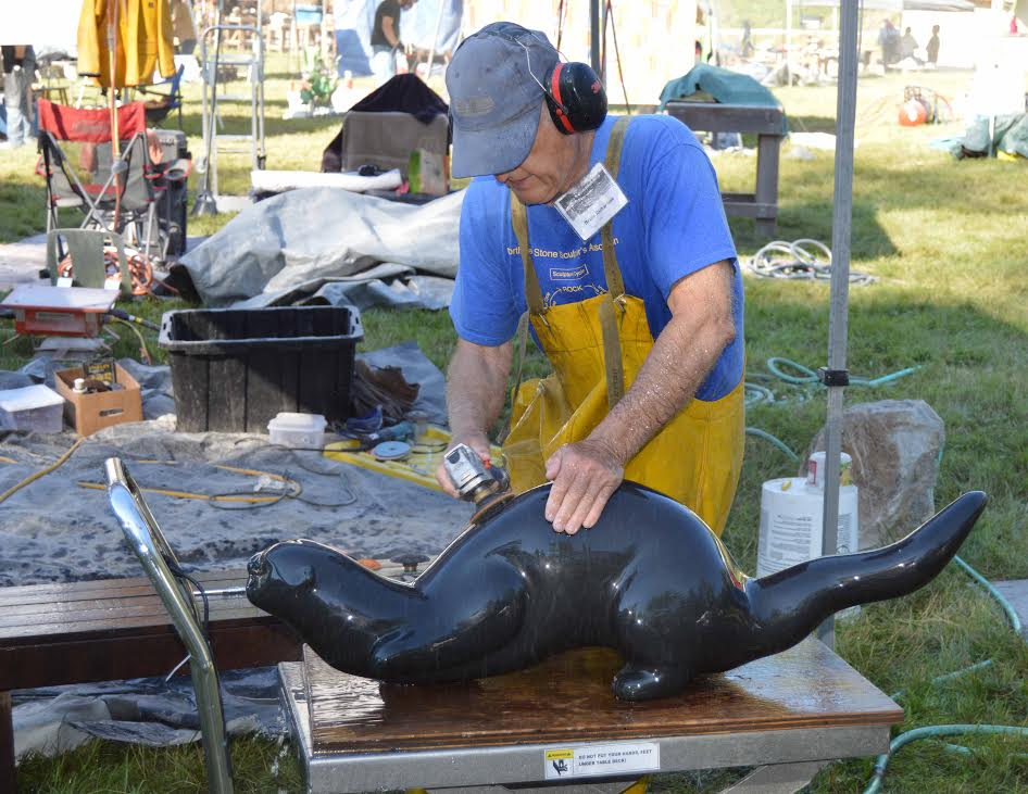 "Bruce working on ""River Otter"" 42""x12""x12"", columnar basalt"