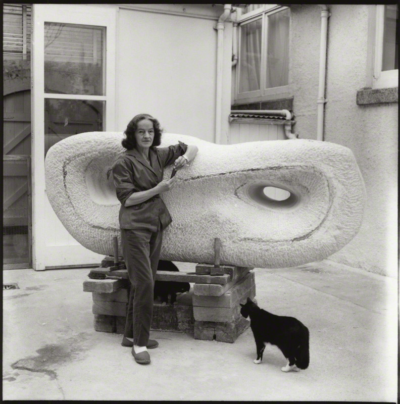 Barbara in her studio circa 1950's, with white marble sculpture and black cat.
