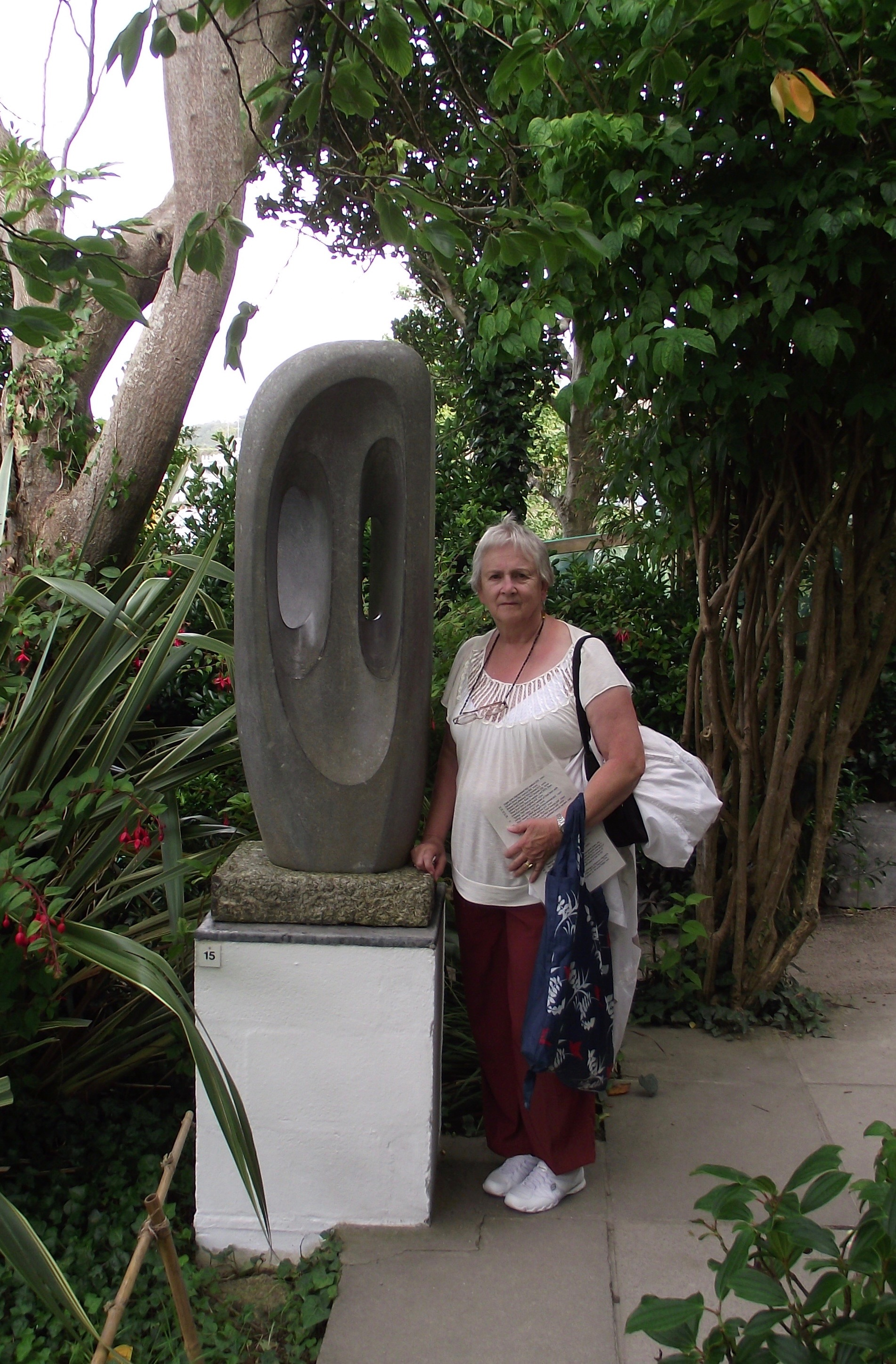 Arliss with a Hepworth sculpture in the garden of Trewyn studio.