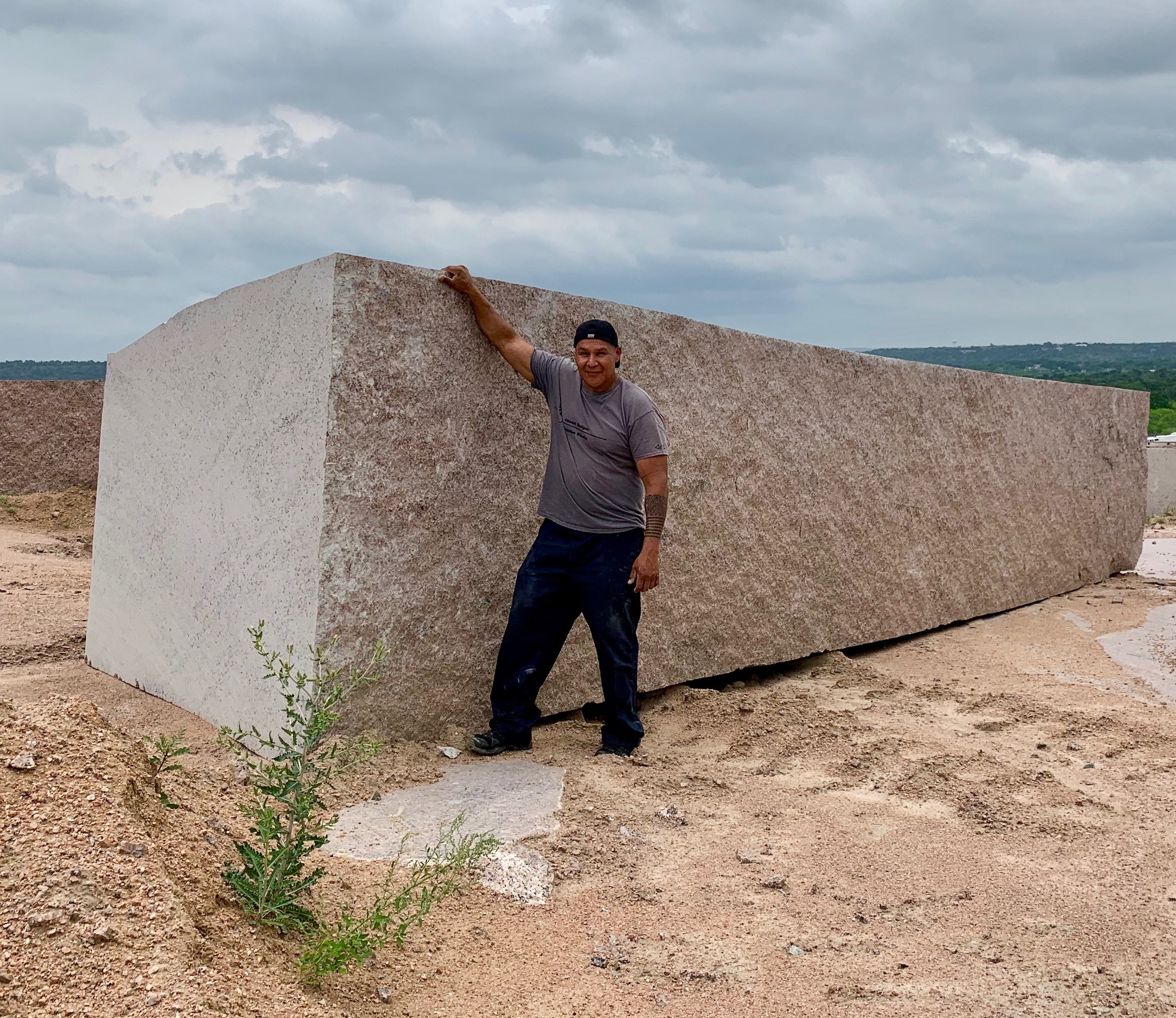 Jason Quigno immediately had to figure out how to take this quarry block home, or at least have his photo taken with it