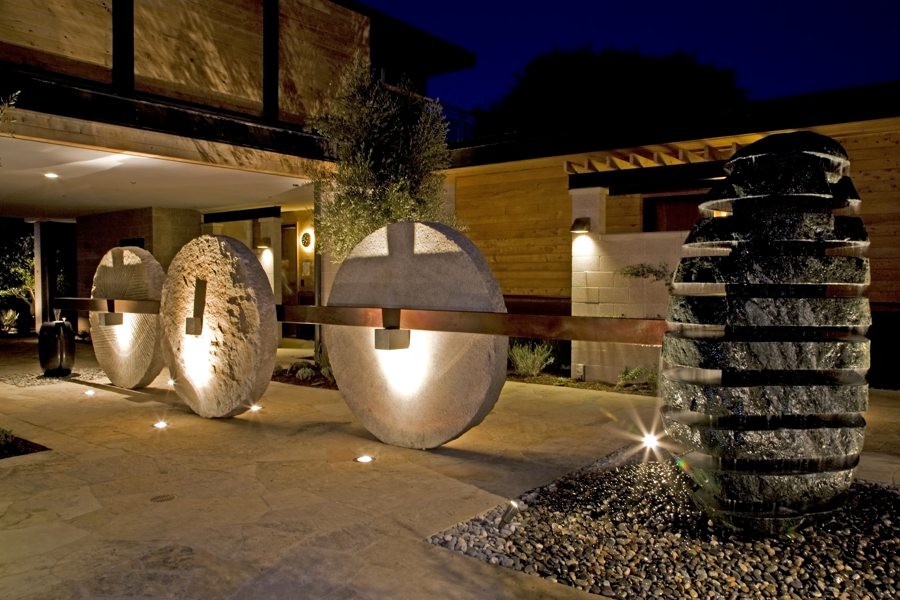 This fountain, featuring wheat grinding stones, was designed and installed in the Olive Courtyard of the Bardessono Hotel.