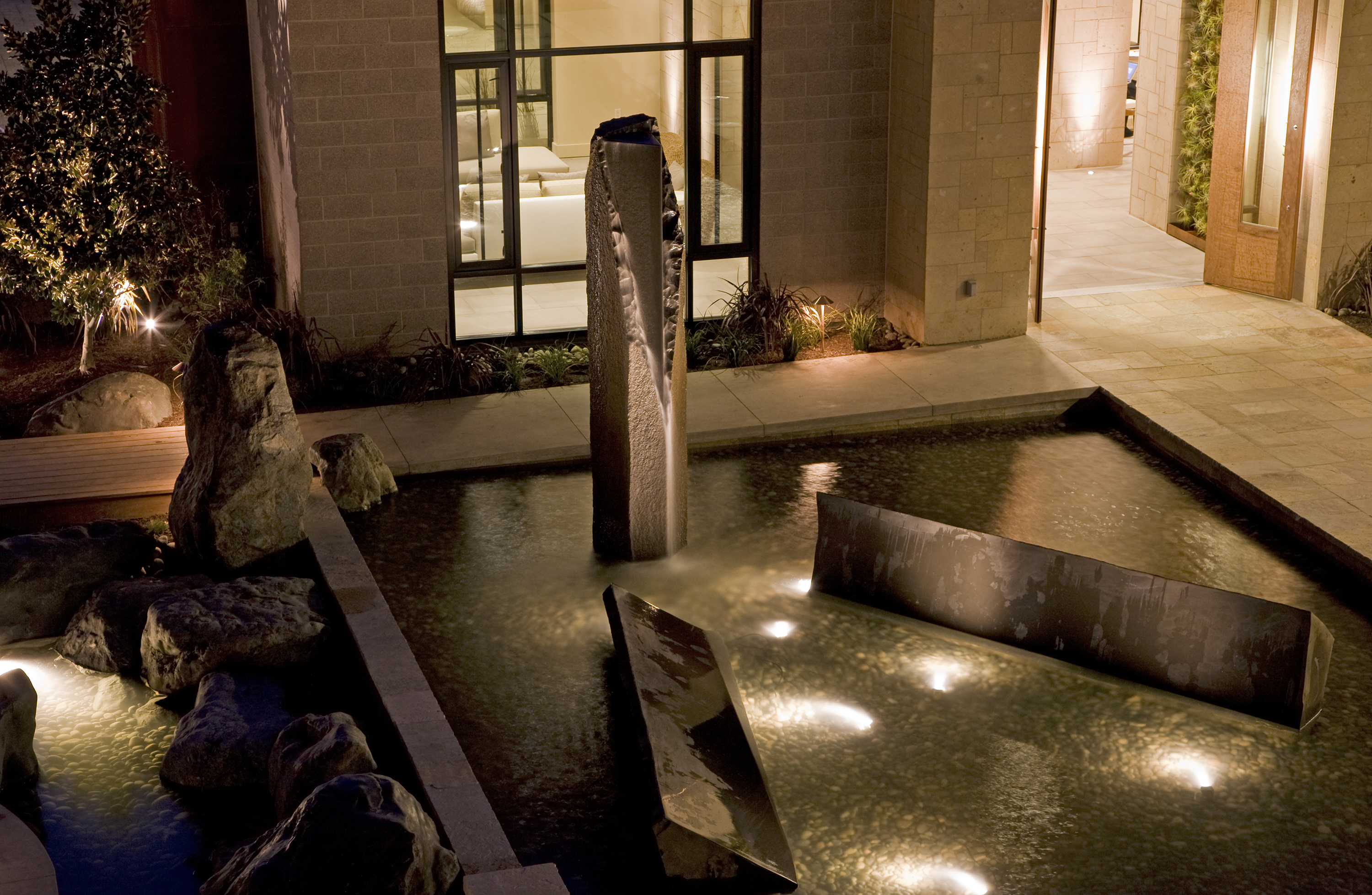 This fountain is near the entrance of the restaurant in the Bardessono Hotel. Rich designed and created all the features within this pool