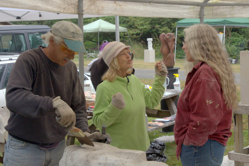 Kimberly Oliver making a point to our AAC instructor Carole Murphy while Mark Andrew works on his cement kissers.