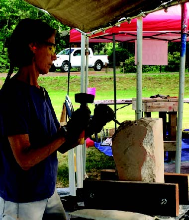 "Beth Kreibel carves in the ""Dojo"" Beginner's Sone Carving Tent"