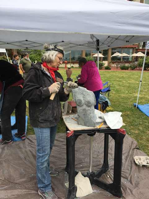 Silvia Behrend sculpts during the Women's Hand Carving weekend. Photo by Carmen Chacon.